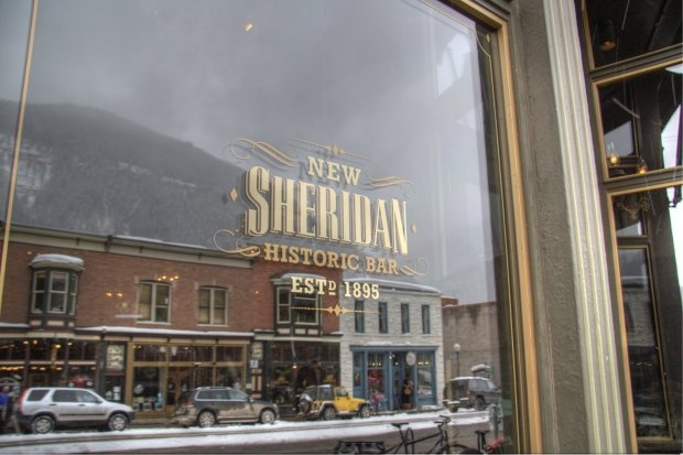 Reflection of downtown Telluride in the window of New Sheridan Chop House