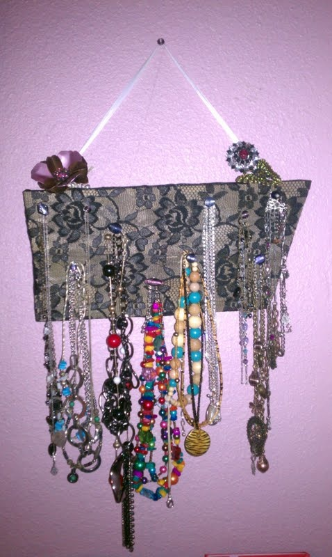 Old fence board, add lace, nails, and glass beads, and instant necklace holder:)