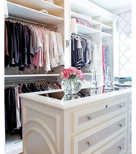 Another dream closet- love the color coordinated system and the tall mirror topped island!