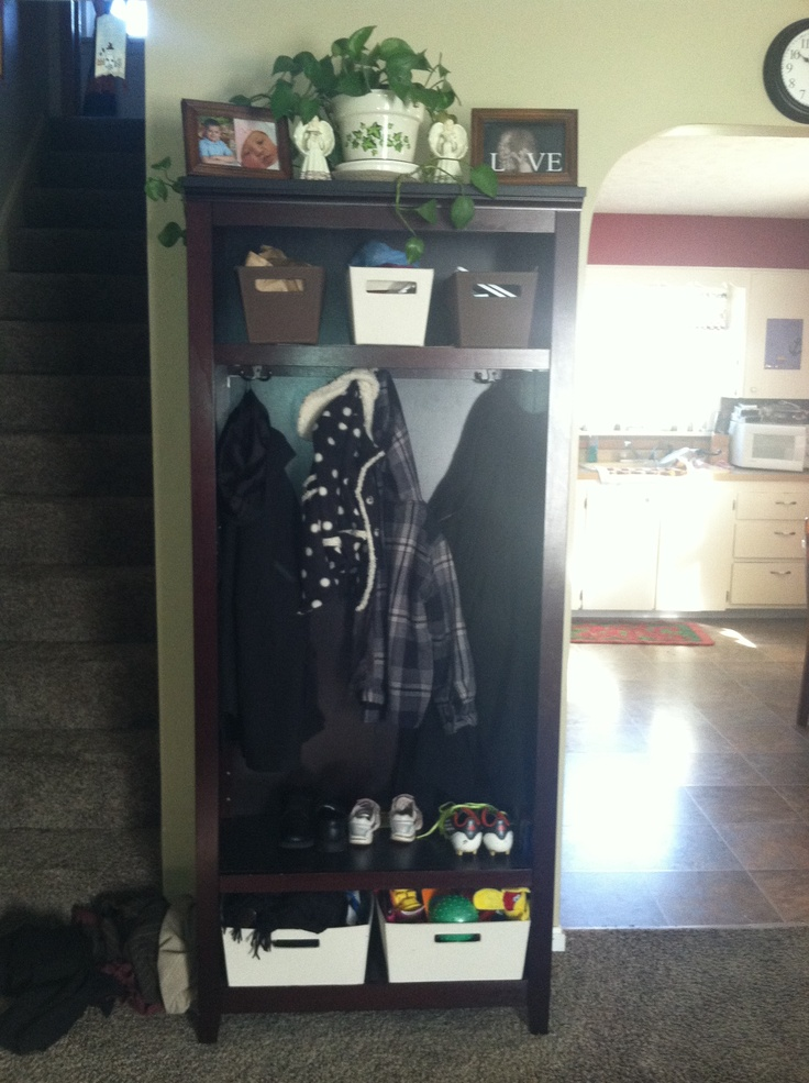 Bookcase  turned into a coat rack with storage for toys or shoes or gloves and mittens.