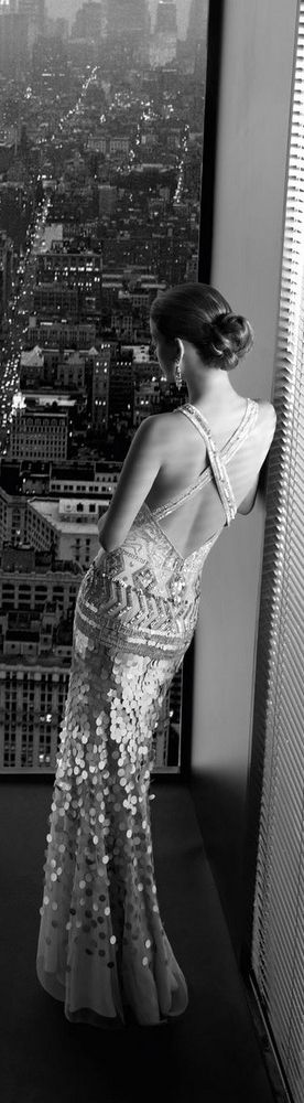 Barbara Palvin for Rosa Clara. Black and white glamour overlooking the city