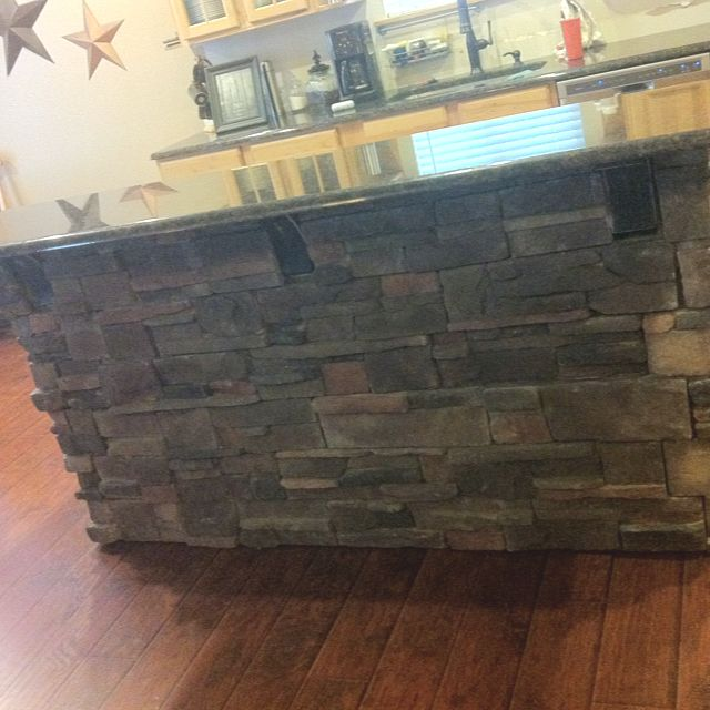 Stacked stone kitchen island we used stone from for Stone kitchen island