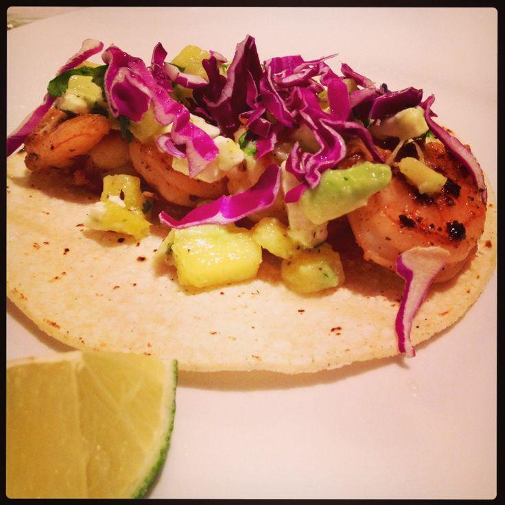 Chipotle shrimp tacos with avocado pineapple cilantro salsa.