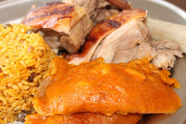 Traditional Puerto Rican meal served during the holidays and special gatherings - lechon asado, arroz con gandules and pastelles.  My mouth is watering just seeing this picture.