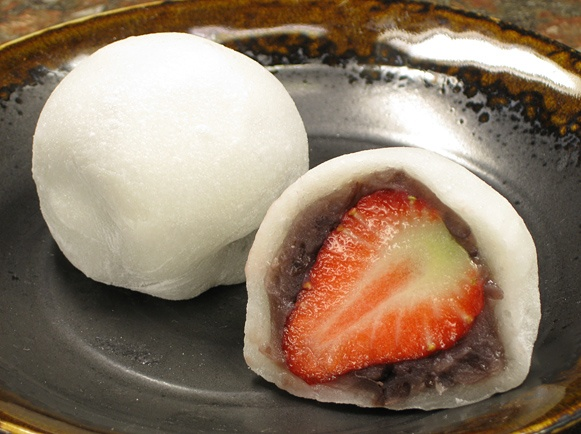 Strawberry Mochi ( ichigo daifuku ) :D Use dark chocolate or nutella ...
