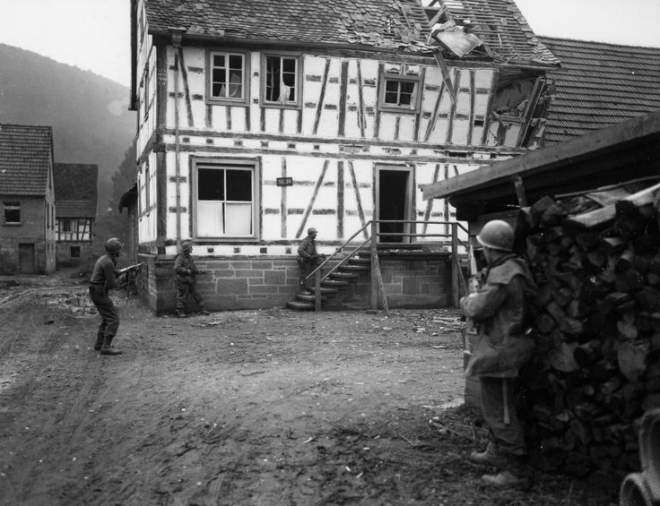Counter-sniper team from the 180th Infantry Regiment, 45th Infantry Division, preparing to enter and clear a house in Bobenthal, Germany on December 16, 1944.