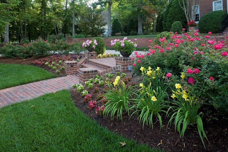 Flower beds garden pinterest for Landscaping flower beds
