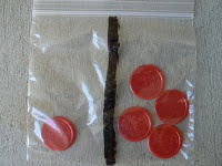 number concept bag: draw a line down the middle of a baggie.  students manipulate and record all math sentences, e.g., 1+4=5.