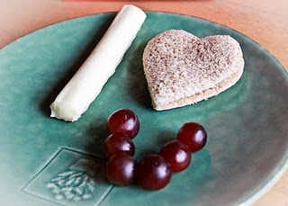 String cheese, heart-shaped sandwich, and some grapes. Valentine snack for the kids.