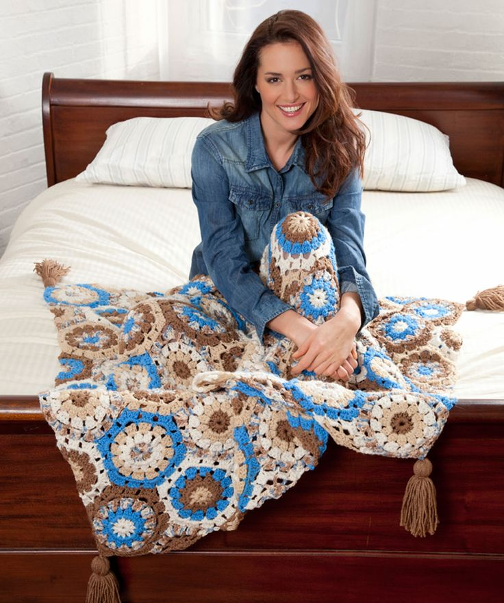 Choose any five yarn colors that make you happy, and crochet this mood lifting throw. Instructions are given for joining the motifs in the last round, which saves you from sewing them together. But if you wish, you can complete each motif separately and sew them together.