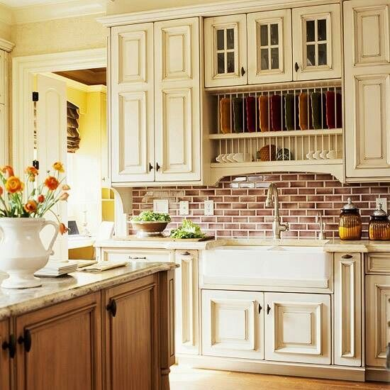 Brick Back Splash And White Cabinets