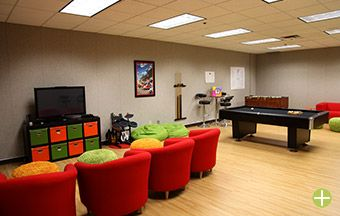 Game Room...different color scheme, but the kid-friendly chairs and TV ...