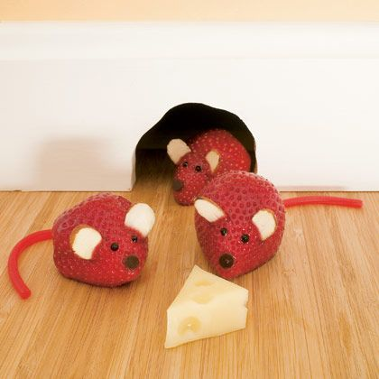 mouse strawberries - strawberry body, licorice tail, chocolate sauce face, almond ears, with a side of cheese