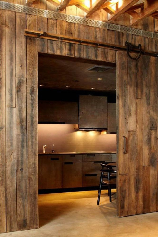 a kitchen behind a sliding barn door my style