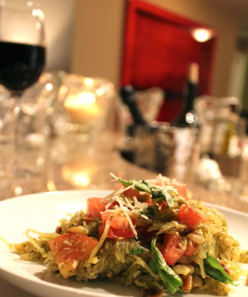 Spaghetti squash pesto with tomatoes and pine nuts, basil and fresh cheese