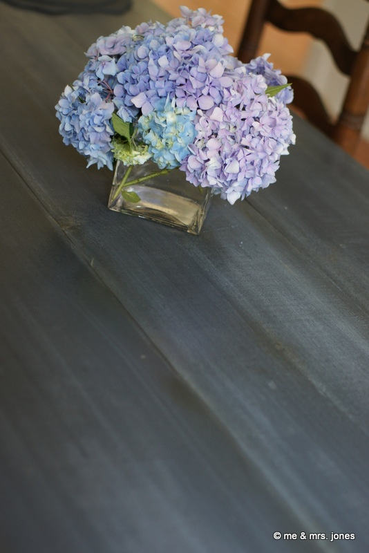 Farm table painted with Chalk Paint® decorative paint by Annie Sloan. Painted in Graphite with a water-spotted Louis Blue wash, streaked with Annie Sloan Soft Wax (Clear and Dark). From Stephanie Jones