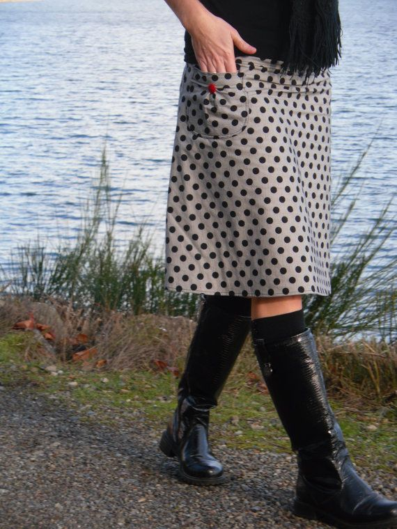 a line skirt with a pocket polka dot black and white