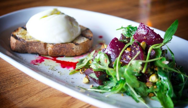 burrata served on top of grilled house bread with roasted red beets ...