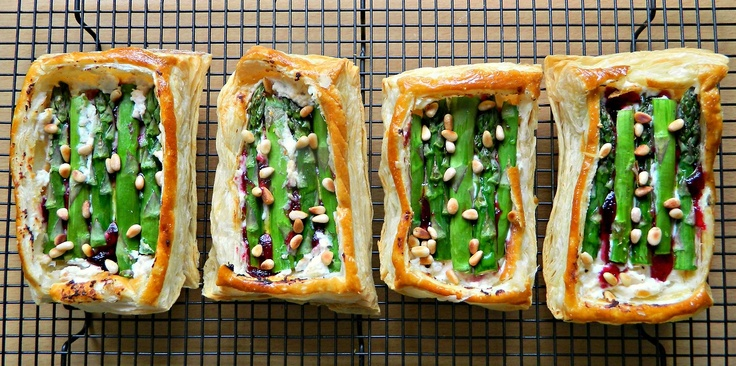 Asparagus/ricotta/cranberry puff pastry tarts with toasted pine nuts.