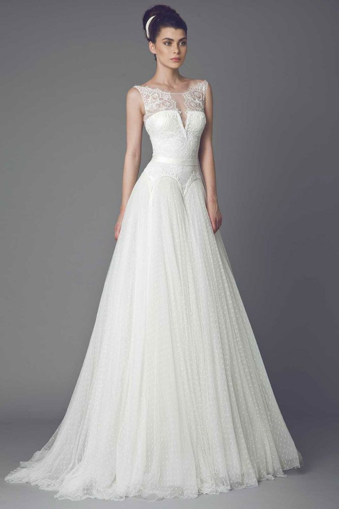 Off White gown with Lace bodice, skirt in Tulle Point D'esprit and belted waist, embellished with lace appliques.