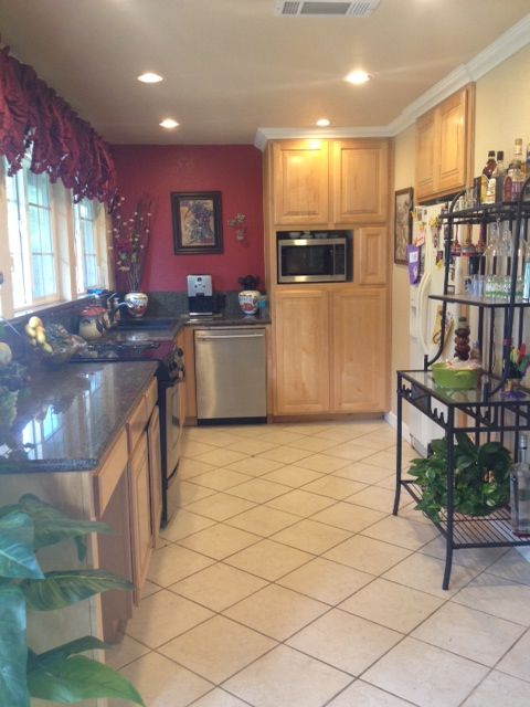 Kitchen red accent wall. | Wine theme kitchen | Pinterest