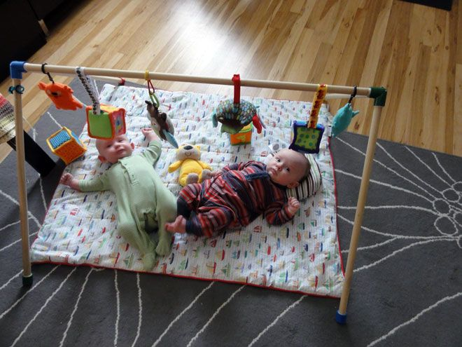 Homemade baby toy gym - wooden dowels & PVC joints