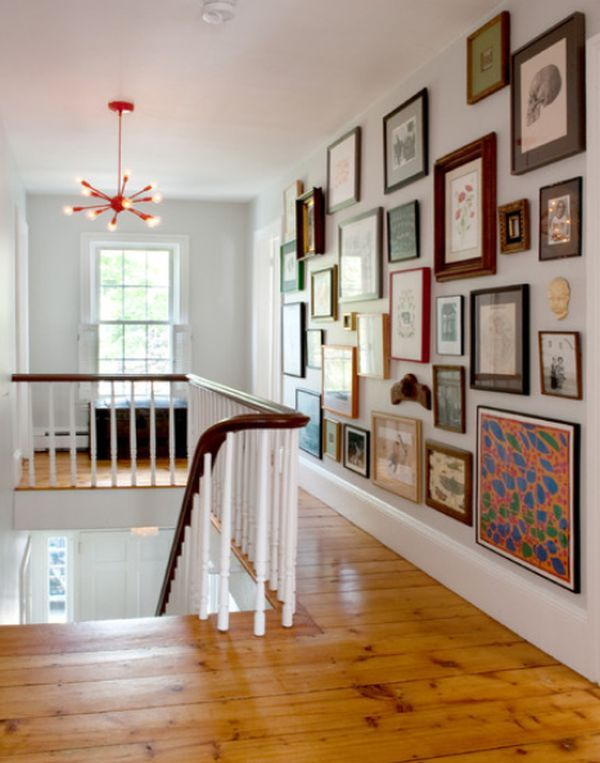 Fantastic modern-vintage gallery wall. (I really love the idea of combining new and old family photos with shadow boxes and artwork you've collected over the years!)