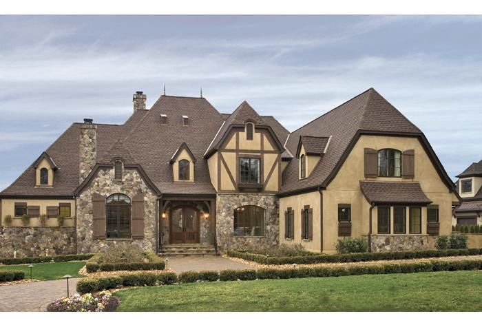 Tudor revival and english cottage style exterior home for Vintage tudor house plans