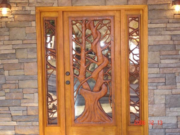 Carved front doors dream home pinterest for Wood doors custom double design carved