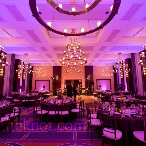 Purple uplighting transformed the ballroom into a chic space.