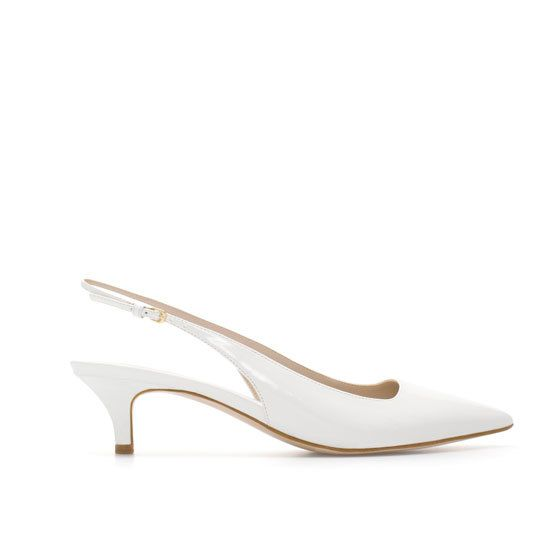 white kitten heel synthetic patent leather sling back shoes