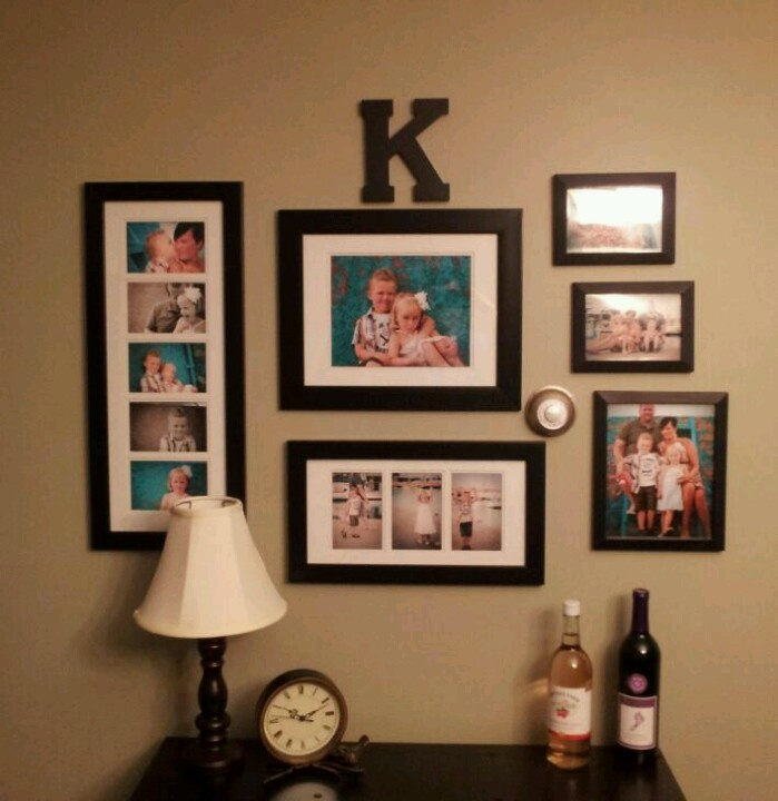 Family photo wall arrangement for the home pinterest - Picture arrangements on wall ...