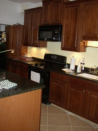 dark cabinets black appliances  In the Kitchen  Pinterest