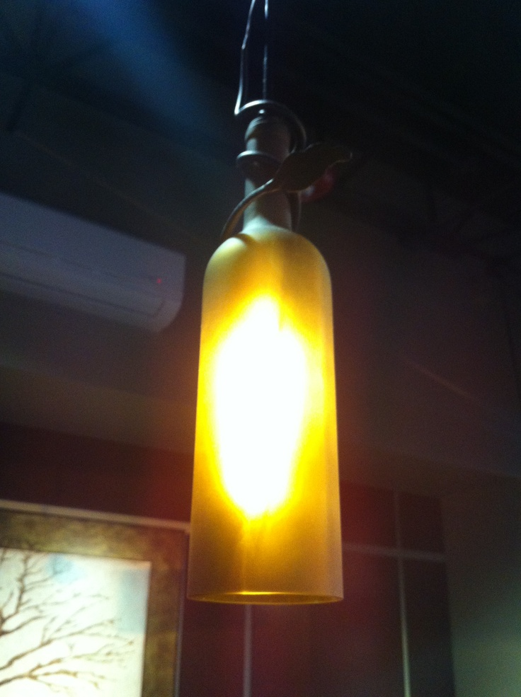 Wine bottle hanging light fixtures.  wine bottle lights  Pinterest