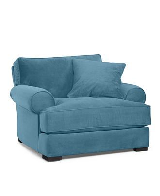 comfy looking overstuffed chair with a matching ottoman just what i