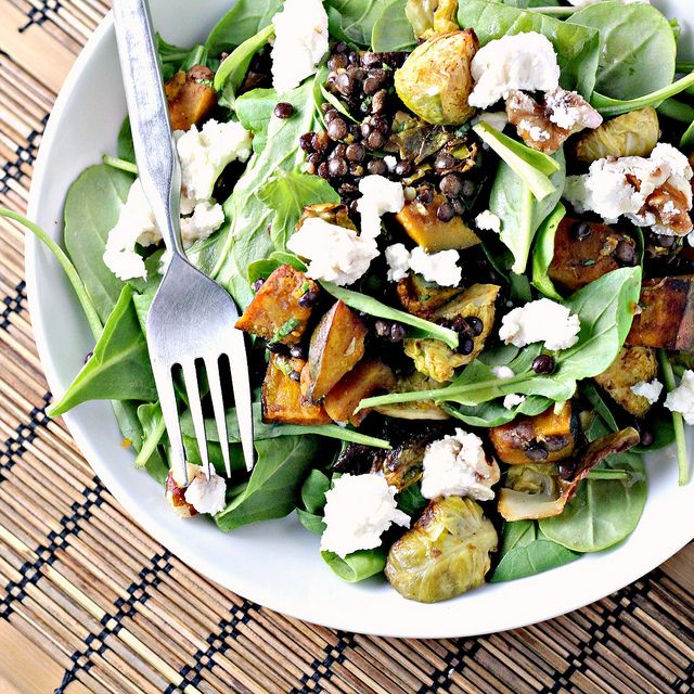 Spicy squash with lentils, brussels sprouts and goat cheese salad