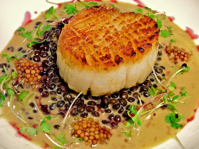 Caviar lentils, shellfish broth finished with uni butter, pomegranite ...