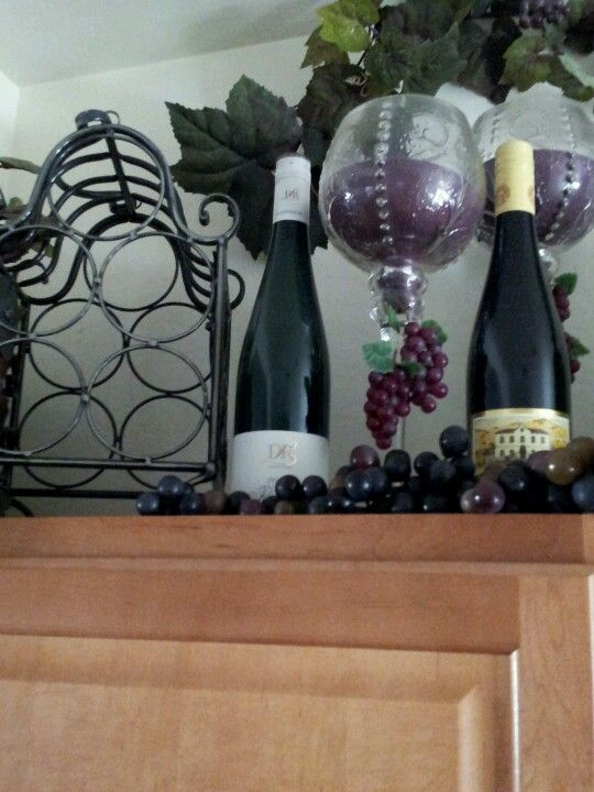 Wine decor hmmm place candles inside the wine glasses w hanging