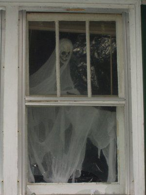 halloween ghosts in the window -