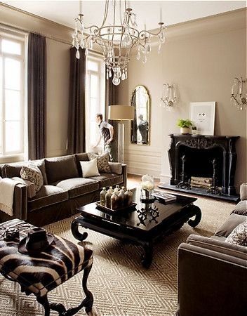 brown and beige...very handsome room but I would have to put a painting with some turquoise or orange over the mantel...otherwide it's just too dull for me.