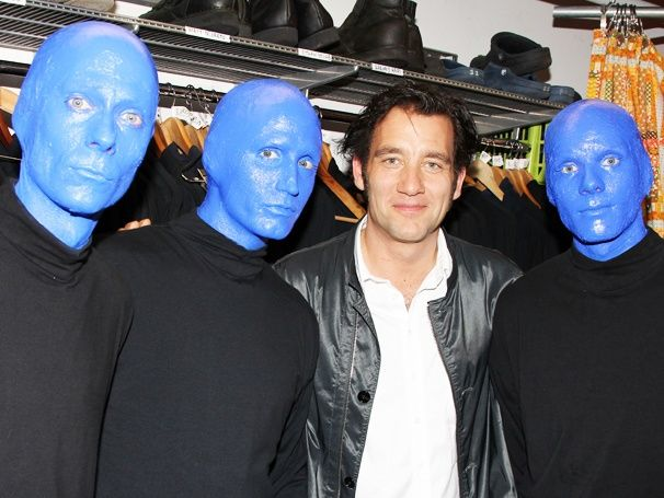 Clive Owen pals around with the stars of BLUE MAN GROUP