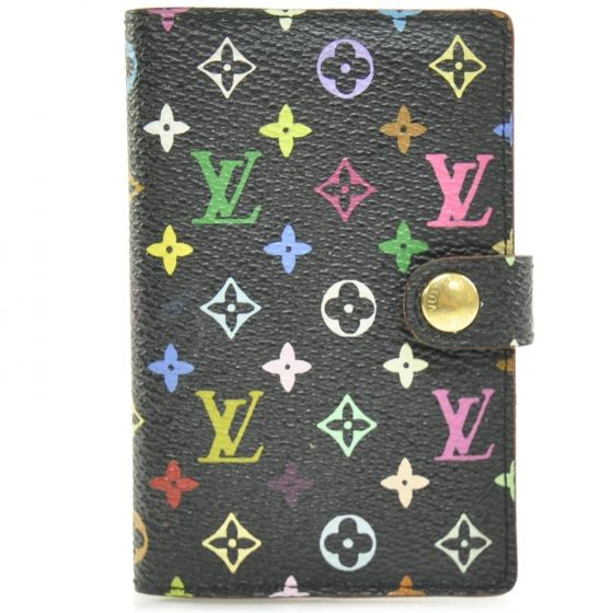 This is an authentic Louis Vuitton Multicolore Carnet de Bal Mini Agenda in Black.  It is a Murakami multicolor canvas design with 33 colors on black.