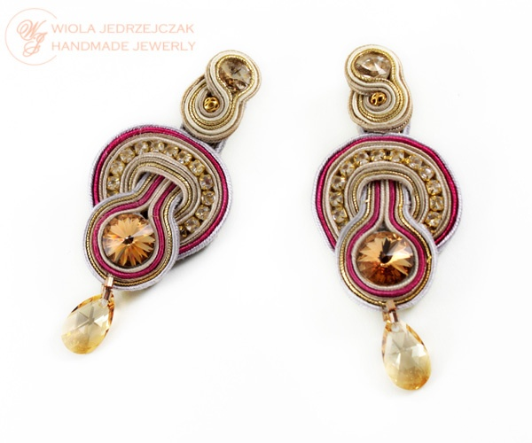 Earrings are made with soutache ribbons, Swarovski crystals, rhinestones. Beige-gold colors, highlighted by a pink line. Length is 8 cm, a width of about 3 cm. Earrings are very lightweight, beige lined the bottom leather, earwires are anti-allergenic, impregnated on both sides.  AVAILABLE