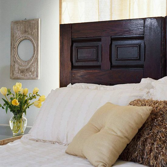 A door from an architectural salvage makes a shabby-chic headboard. More low-cost bedroom updates: http://www.bhg.com/decorating/budget-decorating/cheap/low-cost-bedroom-updates/?socsrc=bhgpin080912recycleddoorheadboard#page=4