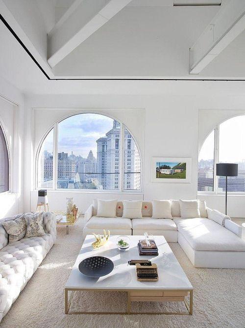 beautiful serene all white interior design skyscraper apartment high ceilings monotone colors neutrals