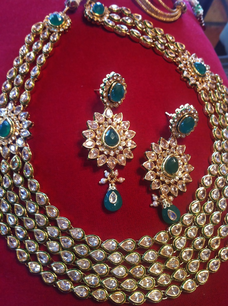 Be Royal, Bold & Distinctive with this Kundan Jeweled Necklace & Earrings.