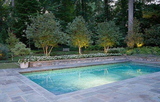 bluestone around pool with white flowers  and good lighting