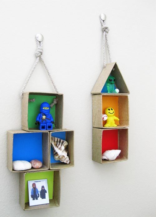Wall decoration with boxes for kids. hmm... wonder if this would help keep random toys off floor?