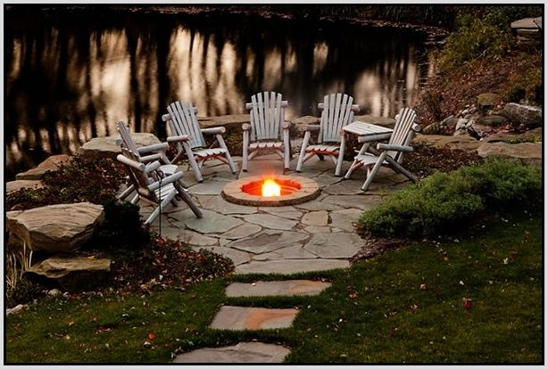 Rustic outdoor fire pit designs love pinterest for Design ideas for outdoor fire pit