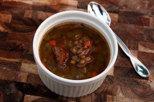 ... lentil soup, while in Italy, it's tradition to eat lentils and sausage